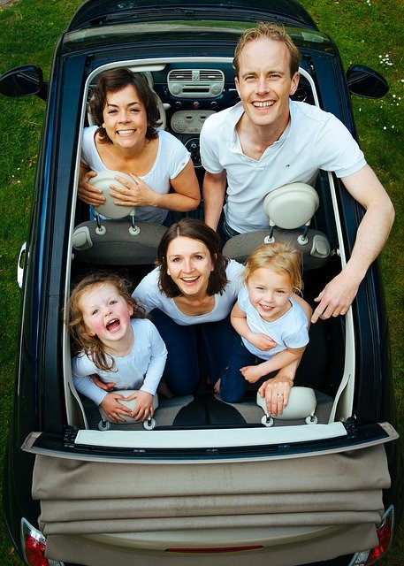 Family in a small car